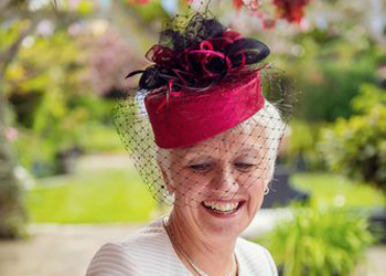 woman in a red pillbox hat