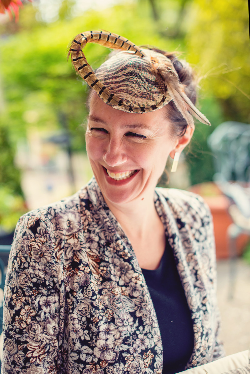 lady wearing an animal print fascinator
