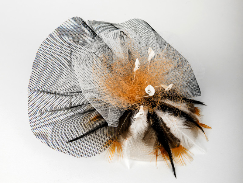 black, tan and white fascinator